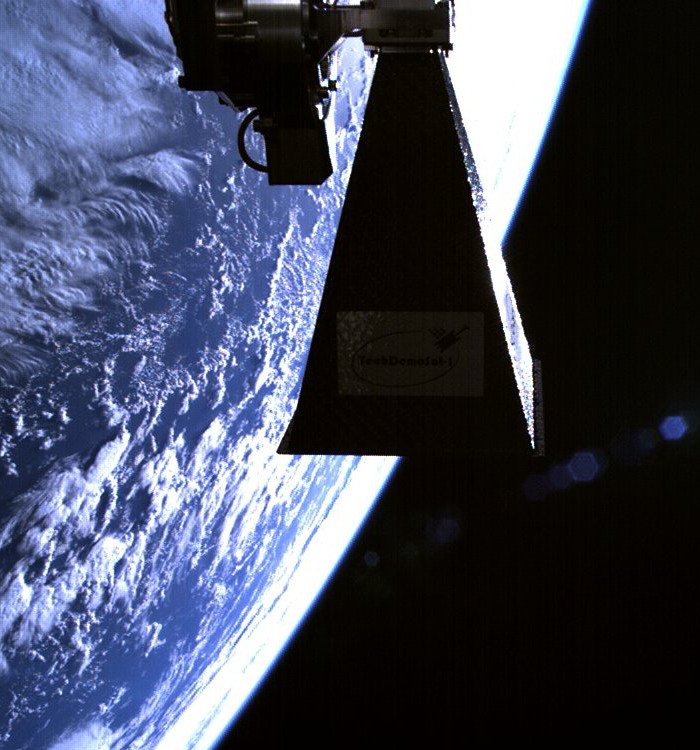 SSTL's TechDemoSat-1 satellite in orbit, showing steerable downlink horn antenna, July 2014.